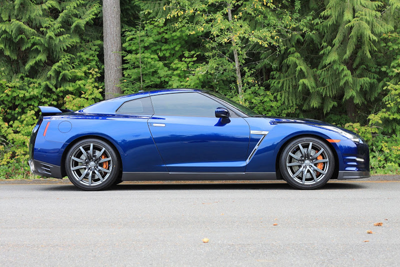 A blue sports car with color stable window tint